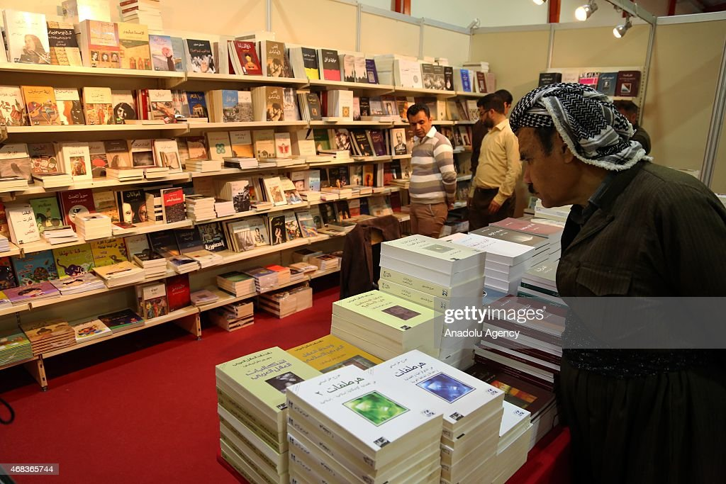 Visitors look at the books during Erbil International Book Fair 2015 including boots of 200 publishers from different countries at Sami AbdulRahman...