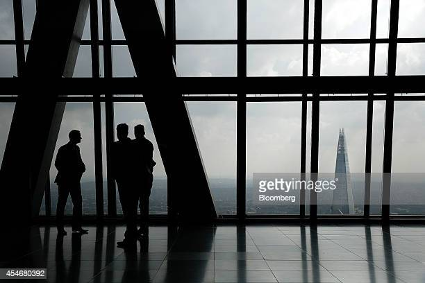 Visitors look at the city skyline including the Shard skyscraper from the 47th floor of the Leadenhall Building also known as the Cheesegrater in the...