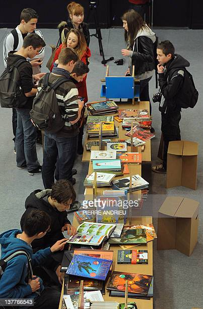 Visitors look at the comics displayed at the 39th edition of Angouleme world comic strip festival headed by American Art Spiegelman on the opening...