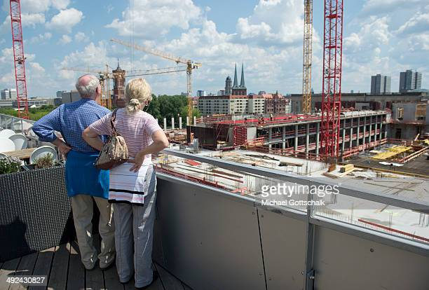 Visitors look at the construction site of Berlin Palace on May 20 2014 in Berlin Germany The palace has been undergoing reconstruction since last...