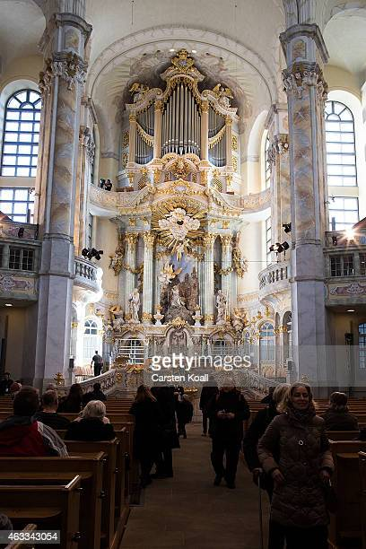 Visitors look at the Frauenkirche before the commemoration of the 70th anniversary of the Allied firebombing of Dresden on February 13 2015 in...