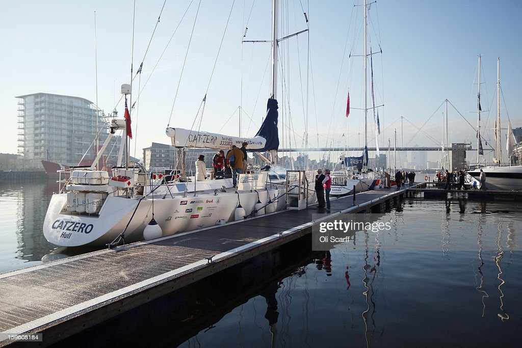 Visitors look at the large boats for sale which are moored in Royal Victoria Dock outside the ExCeL Centre, which is hosting the London Boat Show, on January 17, 2013 in London, England. Until January 20, 2013 the London Boat Show will showcase, demonstrate and sell maritime equipment ranging from luxury yachts to dinghies.