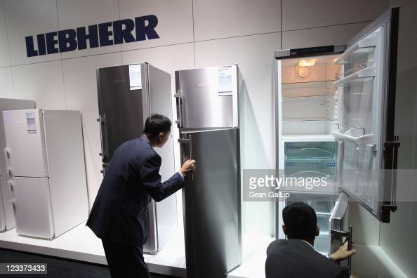 Visitors look at the latest generation of refrigerators at the Liebherr stand at the IFA 2011 consumer electonics and appliances trade fair on the...