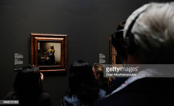 Visitors look at The Milkmaid or Het melkmeisje in Dutch by Johannes Vermeer four days after the Rijksmuseum Official Opening on April 17 2013 in...