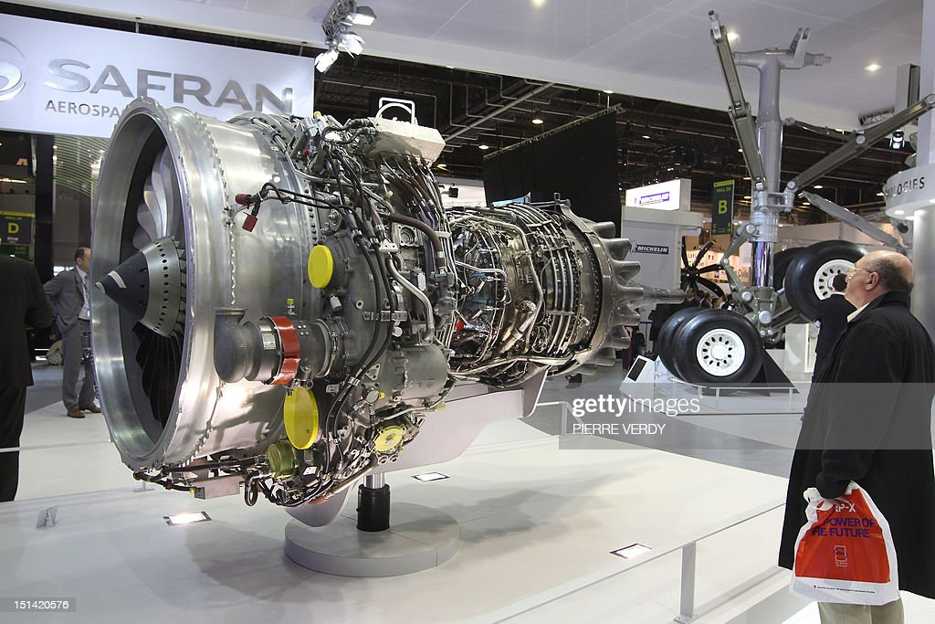 Visitors look at the model of a SaM146 engine by Power Jet a 50/50 joint company of Snecma of France and NPO Saturn of Russia and chosen for the...