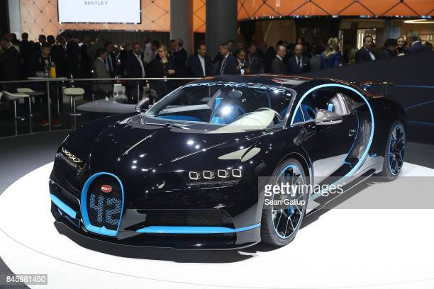 Visitors look at the new Bugatti Chiron at the 2017 Frankfurt Auto Show on September 12 2017 in Frankfurt am Main Germany The Frankfurt Auto Show is...