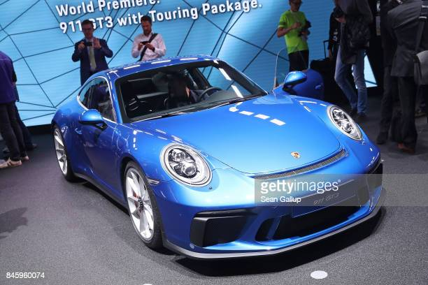 Visitors look at the new Porsche 911 GT3 at the 2017 Frankfurt Auto Show on September 12 2017 in Frankfurt am Main Germany The Frankfurt Auto Show is...