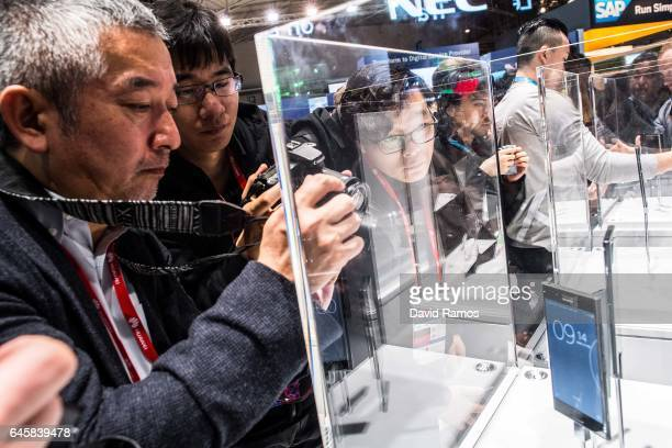 Visitors look at the new Sony Xperia XZ during the Mobile World Congress 2017 on the opening day of the event at the Fira Gran Via Complex on...