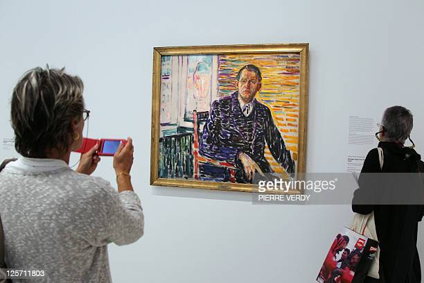 Visitors look at the painting 'Autoportrait a la clinique' at the Centre Pompidou modern art museum also known as the 'Centre Beaubourg' during the...