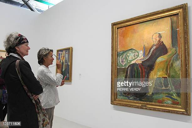 Visitors look at the painting 'Autoportrait avec la grippe espagnole' at the Centre Pompidou modern art museum also known as the 'Centre Beaubourg'...