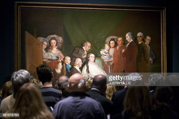 Visitors look at the painting 'The Family of the Infante Don Luis de Borbon 17834' by Spanish artist Francisco de Goya during a press preview of...