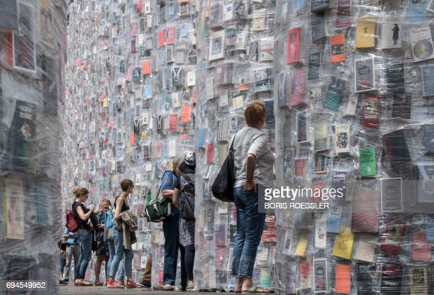 Visitors look at the 'Parthenon of Books' created by the Argentinian artist Marta Minujin during the official opening of the documenta 14 in Kassel...