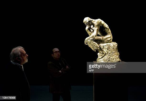 Visitors look at the restored statue 'The Thinker' by Auguste Rodin at the Singer Laren museum on January 28 2011 Rodin's The Thinker along with six...