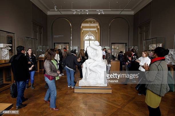 Visitors look at the sculpture 'Le Baiser' by French sculptor Auguste Rodin at the Rodin Museum on November 12 2015 in Paris France After a complete...