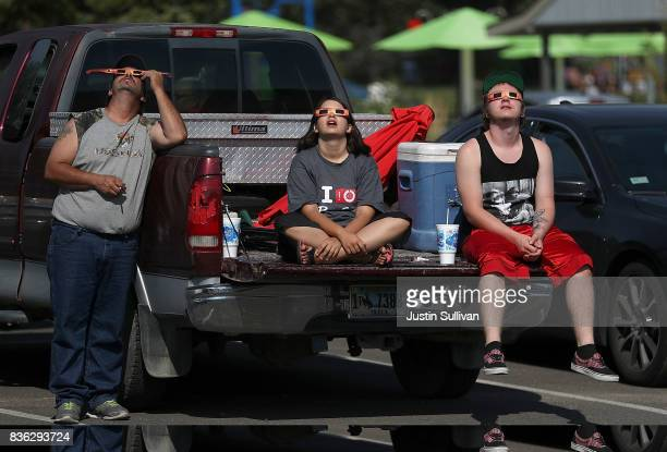 Visitors look at the solar eclipse at South Mike Sedar Park on August 21 2017 in Casper Wyoming Millions of people have flocked to areas of the US...