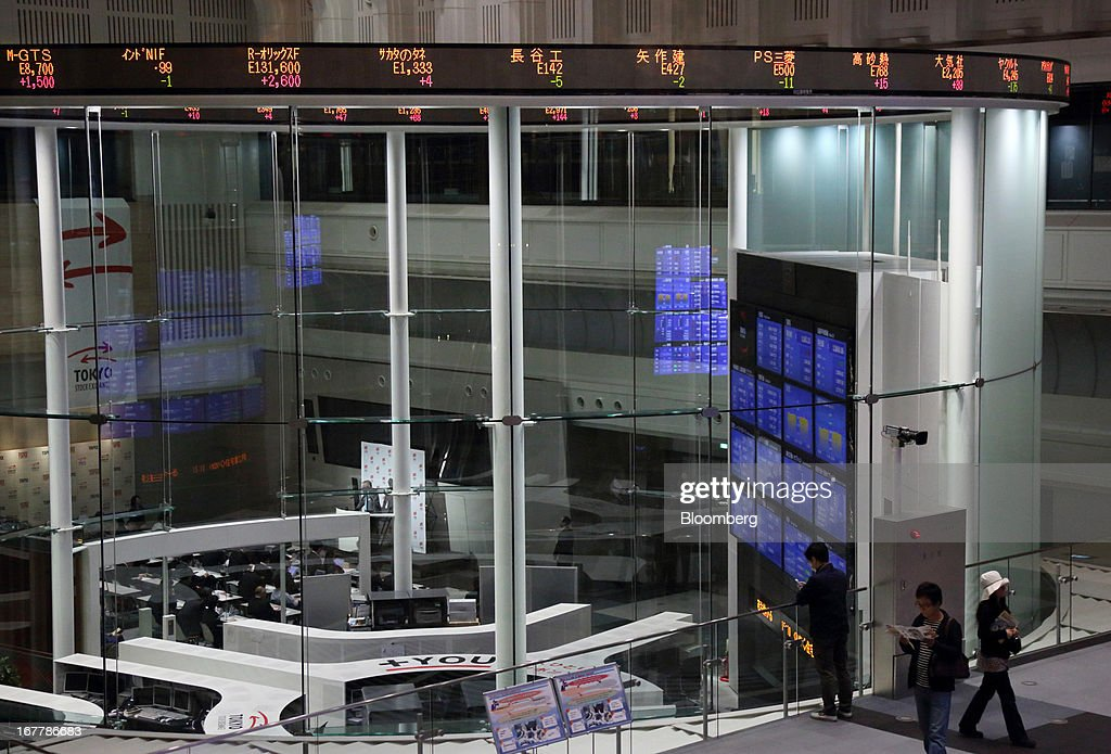 Visitors look at the trading floor of Japan Exchange Group Inc.'s Tokyo Stock Exchange in Tokyo, Japan, on Tuesday, April 30, 2013. Japan Exchange Group Inc. forecast full-year profit that was almost half of analyst estimates in its first annual earnings report after the merger of the Tokyo Stock Exchange Group Inc. and Osaka Securities Exchange Co. Photographer: Tomohiro Ohsumi/Bloomberg via Getty Images