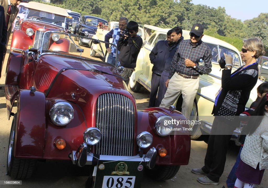 Visitors look at the vintage cars during the '21 Gun Salute Vintage Rally' on December 9, 2012 in New Delhi, India.