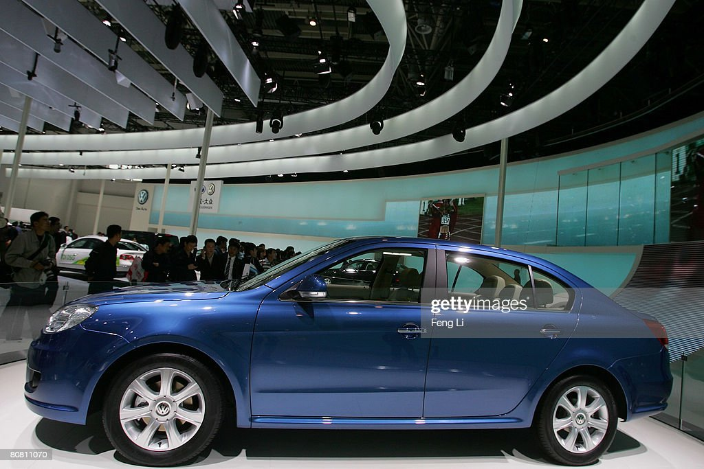 Visitors look at the world premiere display of the Volkswagen Lavida during a special media opening of the Auto China 2008 show at the new China International Exhibition Center on April 21, 2008 in Beijing, China. The annual auto show is held from April 20-28 with 890 vehicles including 55 concept cars on show.
