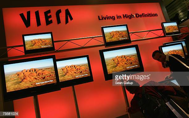 Visitors look at Viera plasma televisions at the Panasonic stand at the CeBIT technology fair March 15 2007 in Hanover Germany CeBIT the world's...
