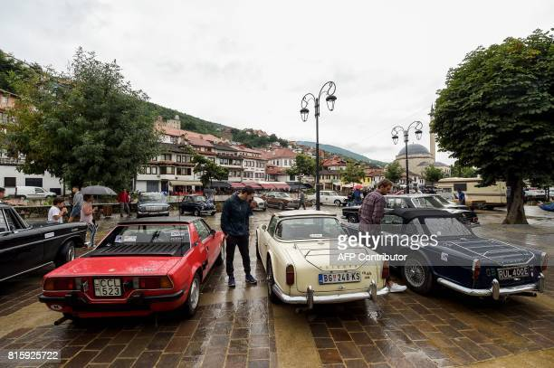 Visitors look at vintage cars displayed during the 12th Old Timer Fest on July 17 2017 in the historic city of Prizren in southern Kosovo / AFP PHOTO...