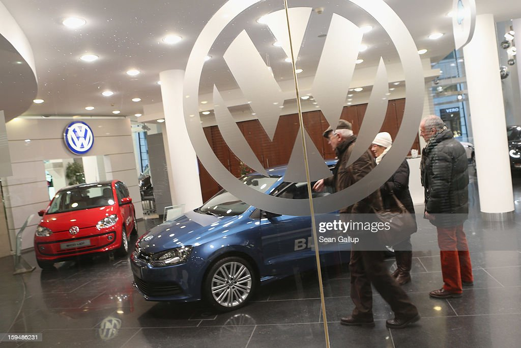 Visitors look at VW cars at a Volkswagen Group showroom on January 14, 2013 in Berlin, Germany. Volkswagen Group, which includes the VW, Audi, Porsche, Skoda, SEAT, Bentley and Bugatti brands, delivered a record 9.07 million cars to customers in 2012. Rising sales in the Americas and Asia helped to offset a drop in sales in western Europe.