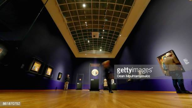 Visitors look at works by Johan Maelwael at the special exhibition held at Rijksmuseum Exhibition on October 13 2017 in Amsterdam Netherlands Johan...