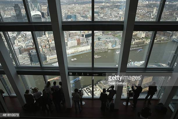 Visitors look down at the Thames River and the city center in this aerial view taken from The Shard on March 21 2014 in London United Kingdom The...