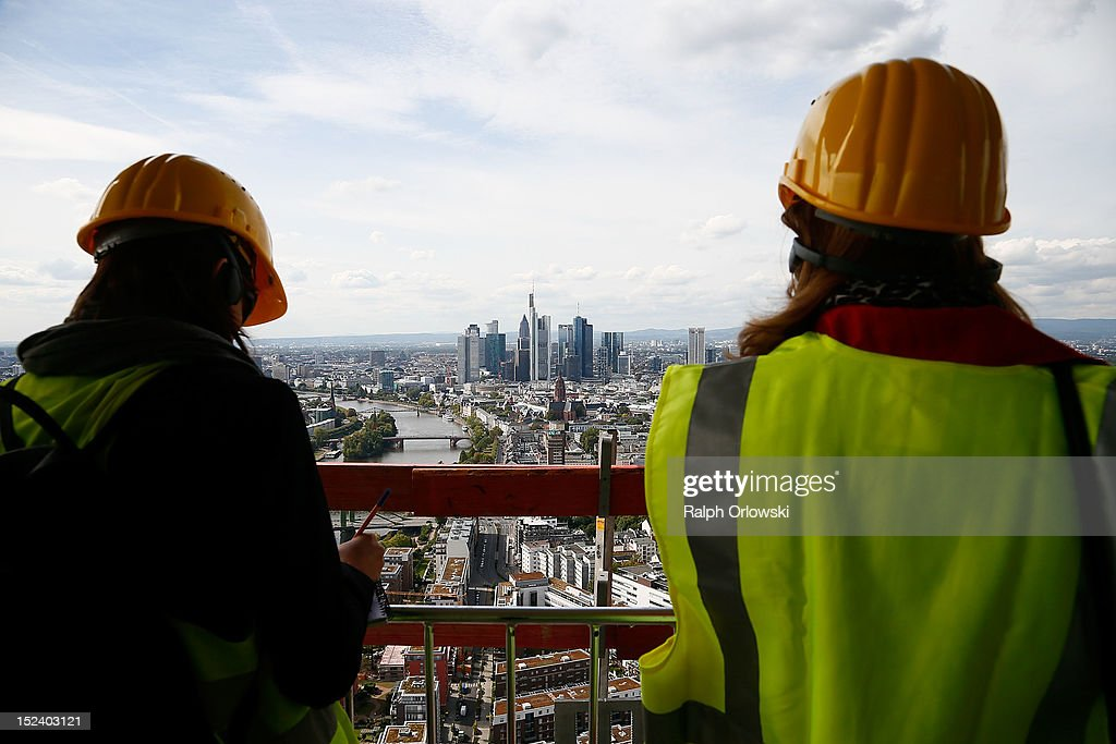 Visitors look from the top floor of the new European Central Bank (ECB) headquarters as construction continues, during a media tour on September 20, 2012 in Frankfurt, Germany. The new twin-tower headquarters is scheduled for completion by 2014.