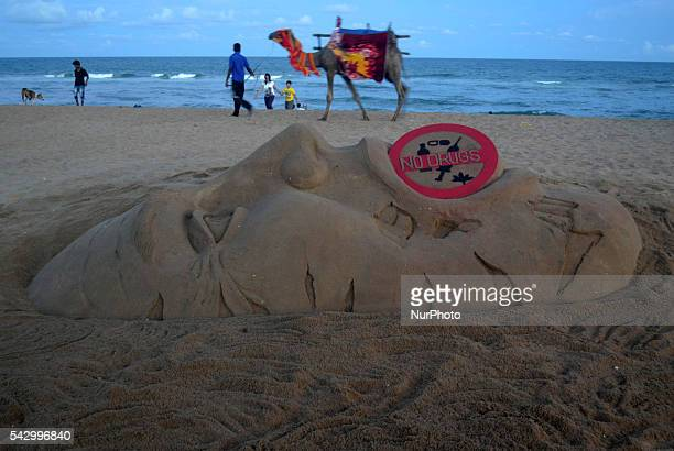 Visitors look near to the Rio Olympic sand sculpture creating by sand artist Sudarshan Pattnaik after Indian runner Dutee Chand qualify for upcoming...