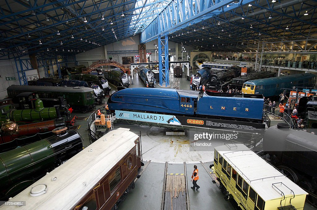 Visitors look on at the steam locomotives on display at the National Railway Museum on July 3, 2013 in York, England. The National Railway Museum's 'Great Gathering' marks 75 years since the world's fastest steam locomotive, Mallard, is reunited with its five sister locomotives on the anniversary of its world record breaking run in 1938 where the Doncaster built steam legend raced into the record books at Stoke Bank near Grantham. The other locomtovies were Sir Nigel Gresley, Dwight d Eisenhower, Union of South Africa, Bittern and the Dominion of Canada.