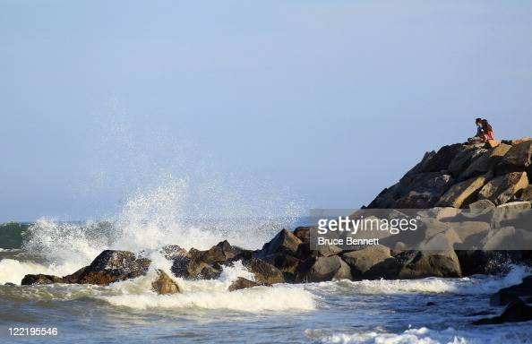 Visitors look out at the huge waves prior to the arrival of Hurricane Irene on August 26 2011 in Montauk New York