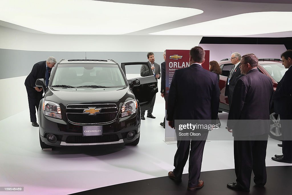 Visitors look over a Chevrolet Orlando, which is produced by General Motors South Korea, during the media preview at the North American International Auto Show on January 15, 2013 in Detroit, Michigan. The car was part of a display of vehicles which Chevrolet offers for markets outside of the United States. The auto show will be open to the public January 19-27.