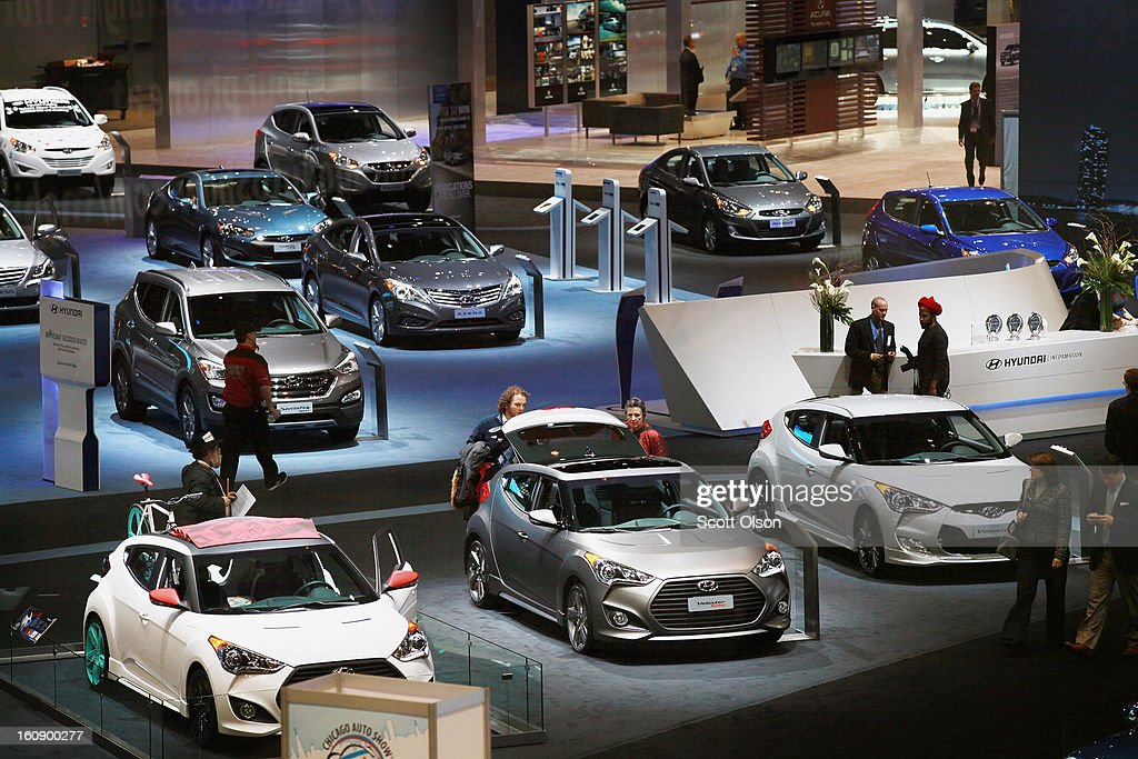 Visitors look over Hyundai cars during a media preview day at the Chicago Auto Show on February 7, 2013 in Chicago, Illinois. The Chicago Auto Show, one of the oldest and largest in the country, will be open to the public February 9-18.
