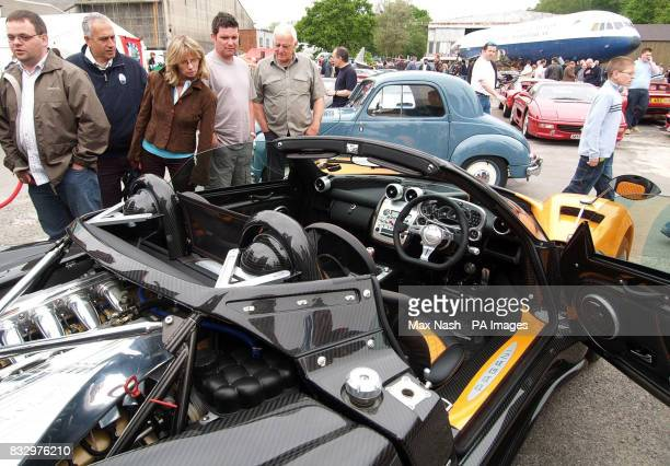 Visitors look over the 580000 Zonda F Roadster with in the background the 1949 Fiat Topolino 500c worth an estimated 130 in 1949 during the...