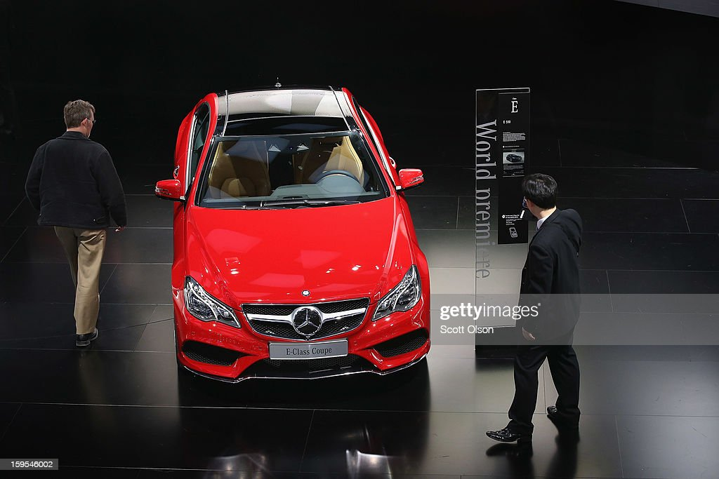Visitors look over the new Mercedes E-Class Coupe during the media preview at the North American International Auto Show on January 15, 2013 in Detroit, Michigan. The auto show will be open to the public January 19-27.