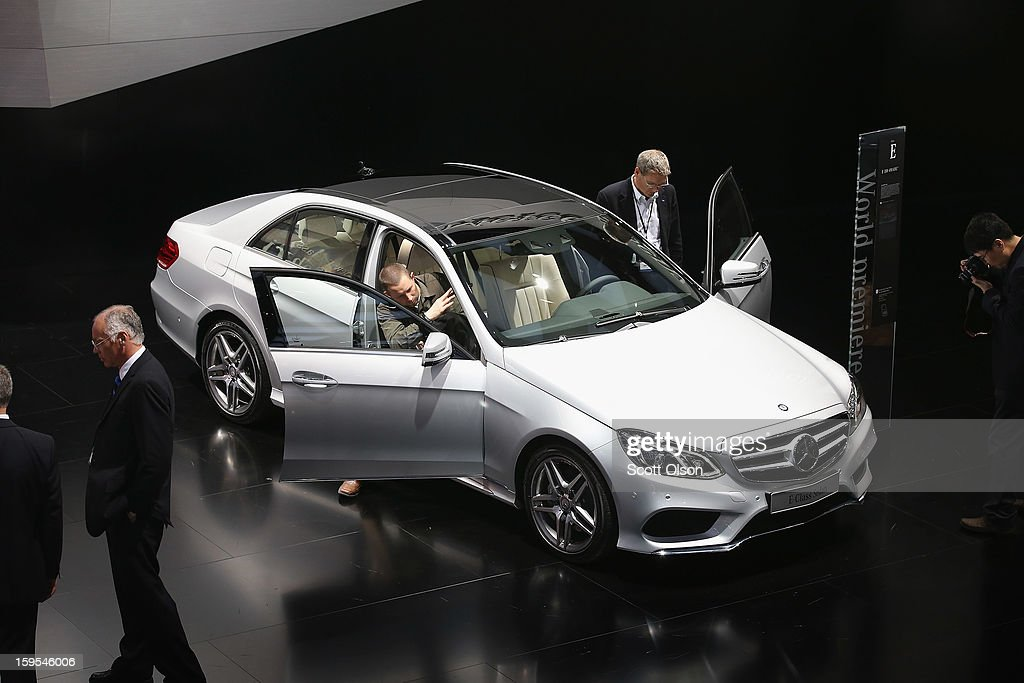 Visitors look over the new Mercedes E-Class Sedan during the media preview at the North American International Auto Show on January 15, 2013 in Detroit, Michigan. The auto show will be open to the public January 19-27.