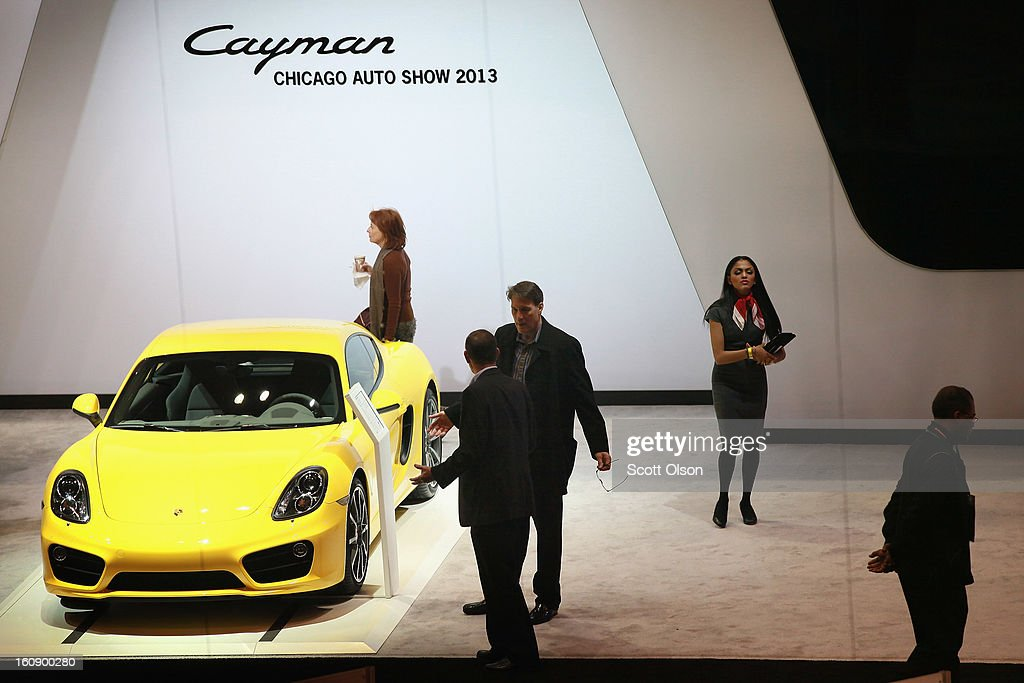 Visitors look over the Porsche Cayman during a media preview day at the Chicago Auto Show on February 7, 2013 in Chicago, Illinois. The Chicago Auto Show, one of the oldest and largest in the country, will be open to the public February 9-18.