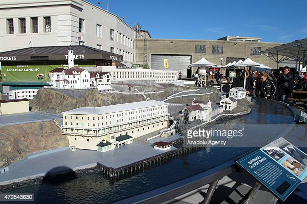 Visitors look the model of Alcatraz 'The Rock' former highsecurity prison and now a museum in San Francisco Bay of California on April 15 2015 'The...