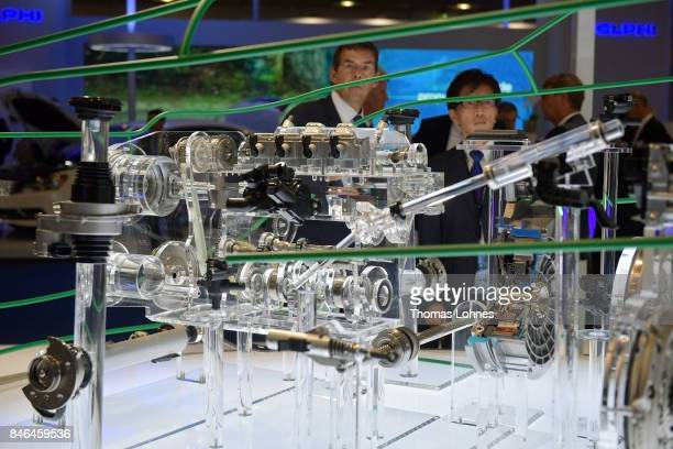 Visitors look to a model of an electric motor at the presentation of 'Schaeffler' at the 2017 Frankfurt Auto Show 'Internationale Automobil...