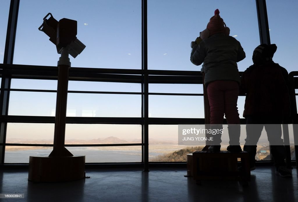 Visitors look toward North Korea's border county of Kaepoong from a South Korean observation post in Paju near the Demilitarized Zone (DMZ) dividing the two Koreas on January 25, 2013. North Korea on January 25 threatened 'physical counter-measures' against rival South Korea, the latest in a series of bellicose warnings sparked by a tightening of UN sanctions against Pyongyang.