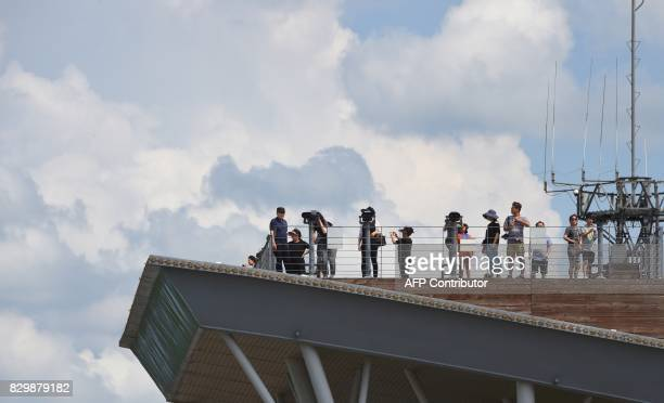 Visitors look towards the North at Imjingak peace park near the Demilitarized Zone dividing the two Koreas in the border city of Paju on August 11...