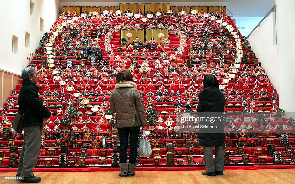 Visitors look up the thirty-tiered, 1,000 Hina-dolls at Sekai-no-Mingei-Ningyo Museum on January 23, 2013 in Suzaka, Nagano, Japan. The dolls, usually seven-tiered, is to celebrate the Girls' Day on March 3.