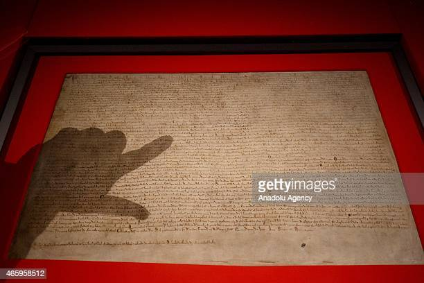 Visitors looking at one of the original 1215 Magna Carta manuscripts as 'Magna Carta Law Liberty Legacy' exhibition opens at the British Library in...