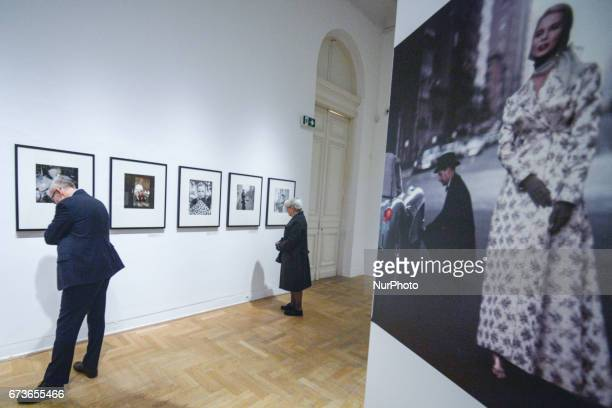 Visitors looking pictures by US photographer Gordon Parks at the exhibition The Camera Is My Weapon in Zacheta the National Gallery of Art in Warsaw...