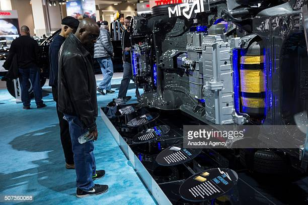 Visitors looks at a cutaway of the Fuel Cell system for the Toyota Mirai Prototype at the Washington Auto Show in Washington USA on January 28 2015