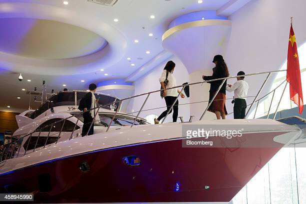 Visitors looks at a Sunbird Yacht Co Phoenix 55foot yacht at the company's showroom inside the Zhuhai Gaolan Port Economic Zone in Zhuhai Guangdong...