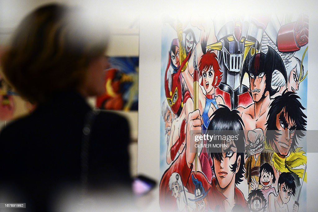 A visitors looks at drawings in an exhibit of the 'Milano Manga Festival' on May 2, 2013 during the press preview in Milan. The exhibition, tracing the 200-year history of Japanese manga will run from May 3 to July 21.