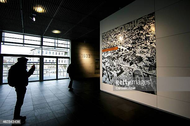 A visitors looks at exhibits at the Topography of Terror documentation center and museum on January 27 2015 in Berlin Germany Thousands of people...