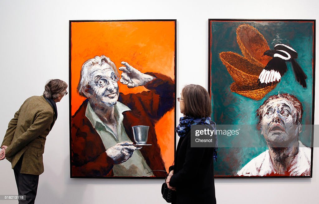 Visitors looks at paintings by French artist Gerard Garouste entitled 'Le Maitre Echanson et le Maitre Panetier' during the 2016 Art Paris Art Fair at the Grand Palais, on March 30, 2016 in Paris, France. With Korea as guest of honor, the Paris Art Fair presenting 143 art galleries from 20 different countries will run from March 31 to April 3, 2016.