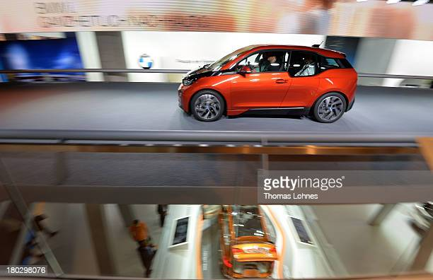 Visitors makes test drive with the first fully electric car BMW i3 of the carmaker BMW at the IAA international automobile show on September 11 2013...
